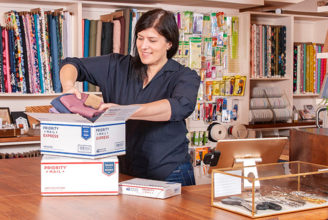 Small business owner preparing to ship with USPS.